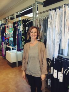 Kari Touhey, boutique manager at Dynamic Body, exhibits yoga accessories.